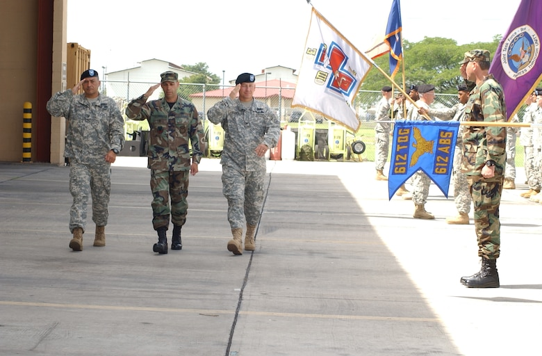 Army Col. Marcus DeOliveira, left, the incoming Joint Task Force-Bravo commander, Lt. Col. Howard Jones, JTF-Bravo deputy commander and Army Col. Christopher Hughes, outgoing JTF-Bravo commander, inspect the troops during the JTF-Bravo change of command ceremony at the Soto Cano Air Base Fire Station June 27. U.S. Air Force photo by Martin Chahin.