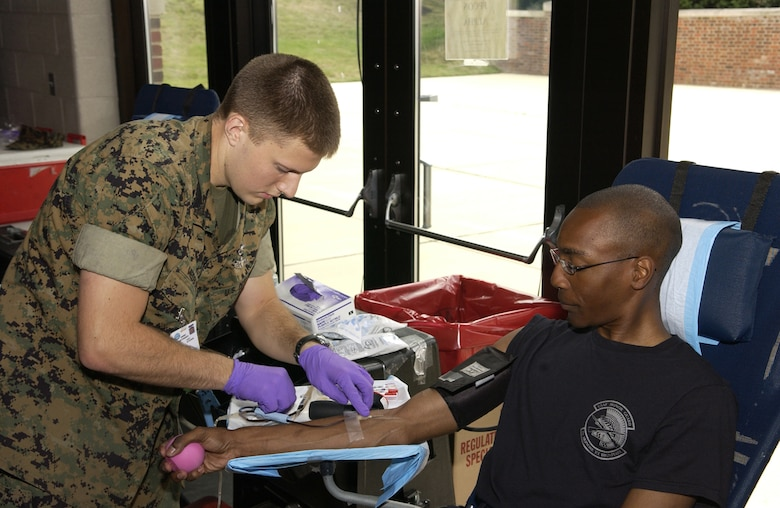 Airman 1st Class Bernard Arthur, U.S. Air Force Honor Guard, donates blood June 25 at the Honor Guard Ceremonial Hall on Bolling. The Armed Services Blood Program holds similar drives four times a week in the National Capital Region. For more information or to donate blood, call ASBP at (703) 681-8024. (U.S. Air Force photo by Airman 1st Class Sean Adams)