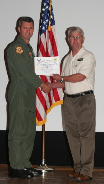 Robert Fuemmeler, 509th Mission Support Squadron, received the Whiteman Spirit Award from Brig. Gen. Greg Biscone, 509th Bomb Wing commander, June 22. (U.S. Air Force photo/Airman 1st Class Steven Linch)