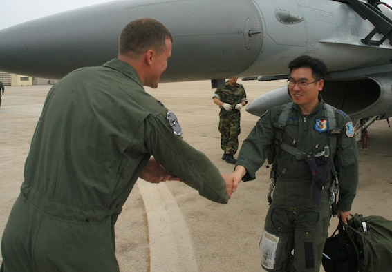 "KUNSAN AIR BASE, Republic of Korea  June 27, 2007 -- Capt. Scott Johnson (left) greets Republic of Korea air force Capt. Yeon, Sang Mo during the 35th Fighter Squadron ""Panton's"" quarterly ""Buddy Wing"" program. The exchange program allows American and ROKAF pilots to learn about each other's flying operations to better operate in the event of hostilities on the peninsula. Captain Johnson is a pilot with the 35th FS. (U.S. Air Force photo/Senior Airman Stephen Collier)"