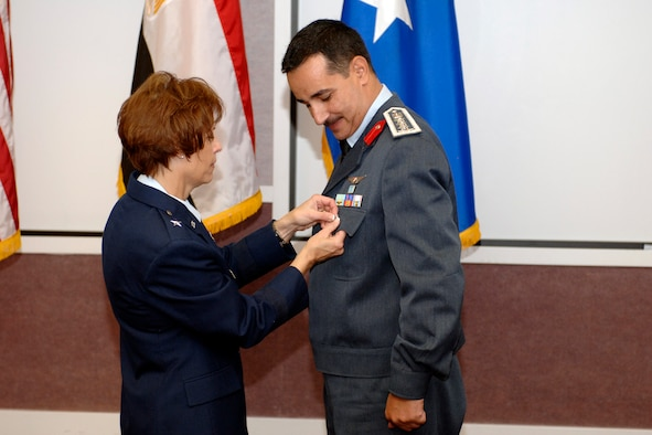 Brig. Gen. Kathleen Close, Ogden Air Logistics Center commander, pins a symbolic star on the pocket of recent promotee Brig. Gen. Hesham Ahmed, Egyptian Air Force international liaison officer, June 28. General Ahmed's duties on Hill Air Force Base include the management of EAF F-16 Fighting Falcons and F-4 Phantoms. (U.S. Air Force photo by Alex R. Lloyd)