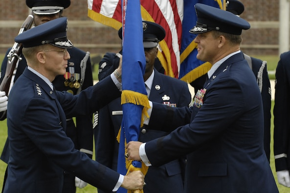 Gen. John D.W. Corley  (left), Air Force vice chief of staff, hands the Air Force District of Washington guidon, signifying command, to Brig. Gen. Frank Gorenc, the new AFDW commander, June 29 on the U. S. Air Force Ceremonial Lawn on Bolling during a combined retirement and change-of-command ceremony. General Gorenc replaces Maj. Gen. Robert L. Smolen, who retired after 33 years of military service. (U.S. Air Force photo by Senior Airman Dan DeCook)