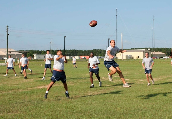"SHAW AIR FORCE BASE, S.C.--First Lt. Matthew Sampson, 9th Operational Weather Squadron weather officer, denies a pass to Master Sgt. Christian King, 28th Operational Weather Squadron weather forecaster, during the ""Ultimate Football"" game Jun 29. (U.S. Air Force photo/Staff Sgt. Erich Wedding)"