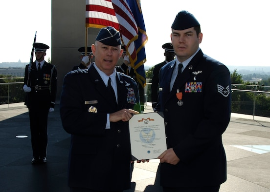 Staff Sgt. Daniel Paxton, right, an aeromedical evacuation instructor assigned to Brooks was among the first to receive the new Air Force Combat Action Medal in a ceremony presided over by Air Force Chief of Staff Gen. T. Michael Moseley, at the Air Force Memorial June 13. (Courtesy photo)