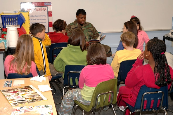 "OSAN AIR BASE, Republic of Korea --  Senior Airman Demetriance Johnson reads ""Buster,"" a children's book, to Mr. Roger Saunder's 3rd grade class at Osan American Elementary School Friday. He was reading as part of the 10th Annual ""Read Across America"" Day, which is sponsored by the National Education Association and is in honor of children's author Dr. Seuss' birthday. Airman Johnson is with the 51st Aeromedical Dental Squadron. (U.S. Air Force photo by Staff Sgt. Benjamin Rojek)"
