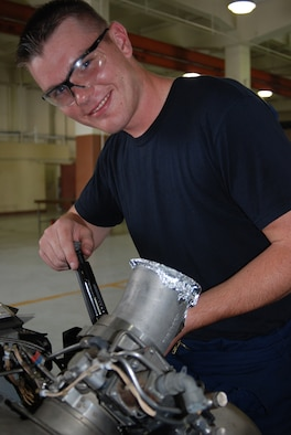 Airman 1st Class Kyle Thomas, 36th Maintenance Squadron aerospace ground equipment mechanic, saved a seven-year-old child?s life at a Norman, Okla., bowling alley while on leave before flying to his first duty station here on Andersen. Airman Thomas received an Achievement Medal for performing the Heimlich maneuver, which he learned in basic military training to eject candy that was lodged in the child?s throat, causing him to choke. (Photo by Senior Airman Angelique Smythe/36th Wing Public Affairs)