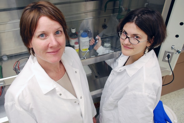 WRIGHT-PATTERSON AIR FORCE BASE, Ohio - Dr. Catherine Harrison (left) and research assistant Amy Huiet demonstrate the Western Blot laboratory technique used to quantify the level of a certain protein in a sample, which helps researchers to determine the effects of the environment on the complexity of the brain. Dr. Harrison is developing neurorehabilitation methods for traumatic brain injury patients. (Air Force photo by Chris Gulliford AFRL/HE)