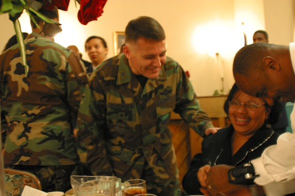 Col. John McDonald, 43rd Airlift Wing Vice Commander, applauds Natalie Boykin, 43rd Services Squadron, for her continuous volunteer efforts with the African American Heritage Committee at the committee's luncheon Tuesday.