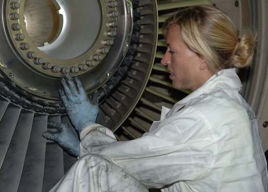 Staff Sgt. Alisha Hutcheson, a KC-135 mechanic currently deployed to the 380th Expeditionary Aircraft Maintenance Squadron from Mcconnell , replaces first-stage fan blades on a Stratotanker engine Feb. 14 at a deployed location. (Air Force photo by Staff Sgt. Kyle Smith)