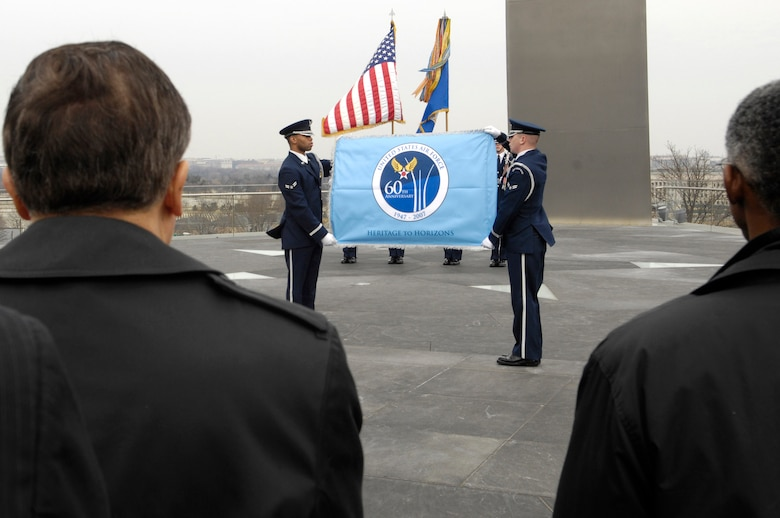 Members of the U.S. Air Force Honor Guard display the Air Force's 60th Aniversary flag during a ceremony at the Air Force Memorial March 1 in Arlington, Va.  The flag will fly at the memorial until the service's 60th birthday Sept. 18. (U.S. Air Force Photo/Senior Airman Daniel R. DeCook)