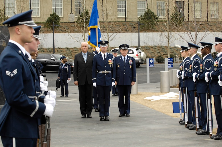 Secretary of the Air Force Michael W. Wynne and Air Force Chief of Staff Gen. T. Michael Moseley are escorted to the base of the Air Force Memorial in Arlington, Va., March 1 for a ceremony in which the Air Force's 60th Anniversary flag was unveiled.  The flag will fly at the Air Force memorial until the Air Force's 60th birthday on Sep 18.  (U.S. Air Force photo/Senior Airman Daniel R. DeCook)