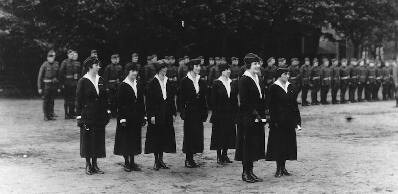 Grace Banker, front left, and some of her colleagues in the Signal Corp Hello Girls line up before receiving recognition for their work in France during World War I.