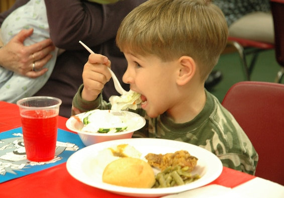 A child feasts on a home-made dinner during Salute to Families. The event was held for the families of deployed Airmen so they would know the services offered by the base while their loved ones are away. (U.S. Air Force photo by 1st Lt. Amy Cooper)