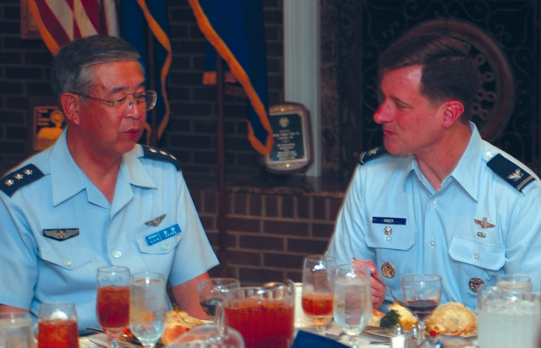 Lieutenant Gen. Osamu Arano, Commander of the Air Training Command for the Japanese Air Self-Defense Force, Japan, enjoys conversation with Colonel Mark Baker, 14th Flying Training Wing Vice Commander, over dinner Wednesday at the Columbus Club. (Photo by 2nd Lt. Justin Jarrell)