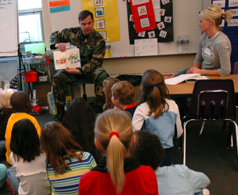 "Col. Steven Muhs, 460 Mission Support Group commander, reads ""And to Think that I saw it on Mulberry Street"" to a group of first and second graders at Murphy Creek K - 8. March 2 was the National Education Association's Read Across America day where volunteers come out to local schools to read to children. The date coincides with the birthday of Dr. Seuss. (U.S. Air Force photo by Staff Sgt. Sanjay Allen)"