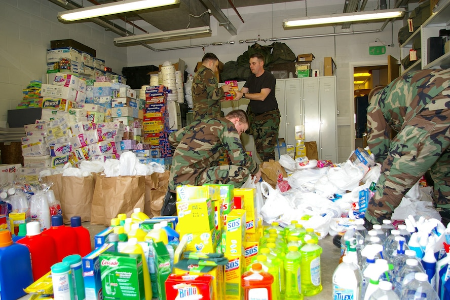 Airmen from the 100th Operations Support Squadron sort through donations from military members and their families donated March 3 and 4 at the RAF Lakenheath Commissary. Members from the 100th Operations Group's Galaxy Team 5/6 committee spent the weekend collecting items as part of the wounded soldier item drive. The items collected will be sent to the Fisher House at Landstuhl in Germany. More than 50 shopping carts-worth of goods were donated; including foil; dishwashing liquid; toilet rolls; paper plates and plastic cutlery; and packets of sugar. (U.S. Air Force Photo by Karen Abeyasekere