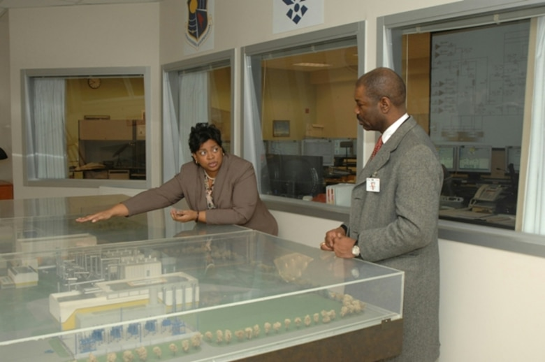 Raquel March explains the role of the Aeropropulsion Systems Test Facility at Arnold Engineering Development Center, Arnold Air Force Base, Tenn., to Neville Thompson during his tour of the base Feb. 23. Mr. Thompson, a senior engineer in the office of the deputy assistant Sscretary of the Air Force (Science, Technology and Engineering), was the guest speaker at AEDC's annual African American Heritage luncheon held at the Arnold Lakeside Club Feb. 23.