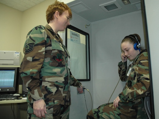 Master Sgt. Michelle Rootes and Airman 1st Class Christina Moran, both from the 5th Medical Operations Squadron, perform a routine inspection of a hearing booth at the 5th Medical Group. Sergeant Rootes recently won two Air Force level awards. Sergeant Rootes was awarded the 2006 Col. Cleveland L. Parker Award - Public Health Senior NCO of the Year and was a member of the Air Force Expeditionary Medics, who were named as the 2007 Air Force Team of the Year. (U.S. Air Force photo by Senior Airman Danny Monahan)