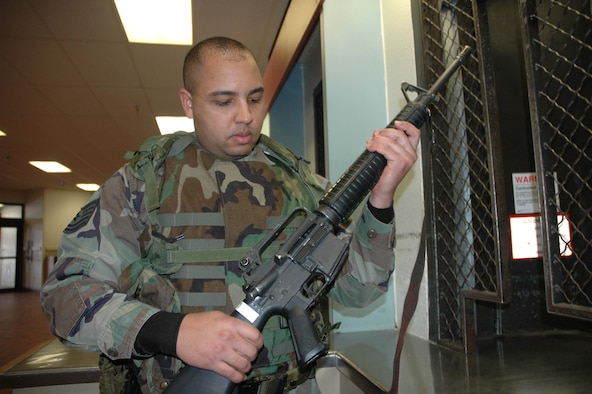 MINOT AIR FORCE BASE, N.D. – Tech. Sgt. Crumel Mooring, Minot Air Force Base Military Equal Opportunity office, checks out an M-16 at the base armory. Sergeant Mooring was recently named the 2006 Air Combat Command Security Forces NCO Augmentee of the Year. (U.S. Air Force photo by Senior Airman Danny Monahan)