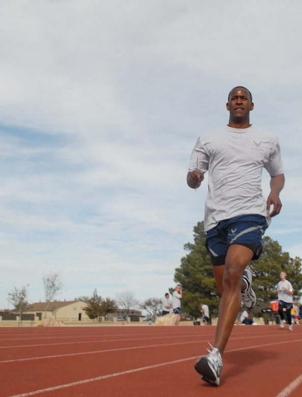 2nd Lt. Brian Williams looks to the finish line while in stride as he takes part in the Couples Fun Run hosted by the 17th Services Division Monday at the base track. (U.S. Air Force photo by Tech. Sgt. Randy Mallard)