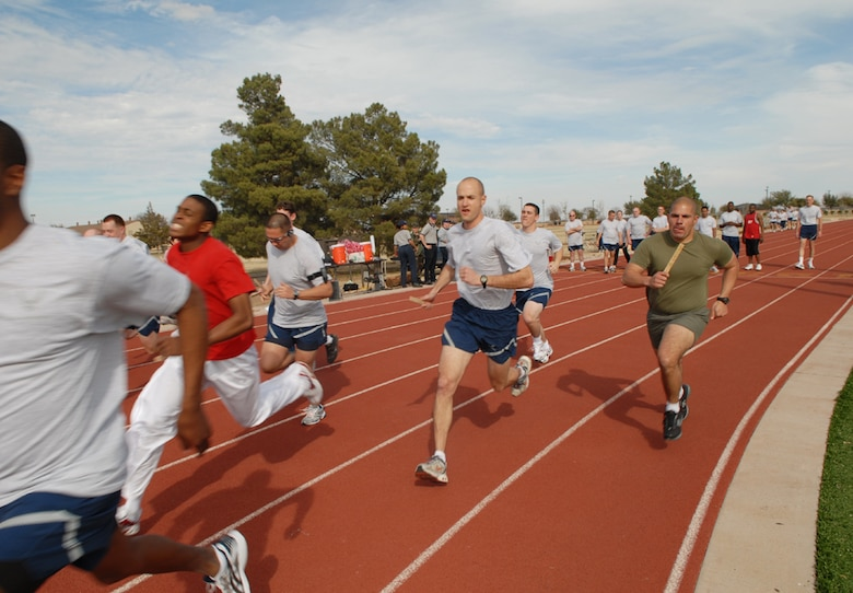 Participants charge toward the finish line at the Couples Fun Run hosted by the 17th Services Division Monday at the base track. (U.S. Air Force photo by Tech. Sgt. Randy Mallard)