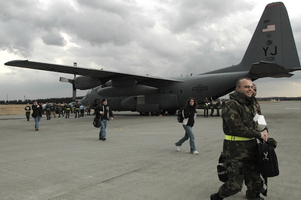 YOKOTA AIR BASE, Japan -- Volunteers from Kunsan Air Base, Korea, offload from a C-130 Hurcules from the 36th Airlift Squadron as part of a Noncombatant Evacuation Operation exercise. The NEO exercise was part of an overall Initial Response Readiness Inspection conducted by the Pacific Air Forces Inspector General to test the 374th Airlift Wing's ability to respond to contingencies throughout the Pacific region. (U.S. Air Force photo by Master Sgt. Dominique Brown)