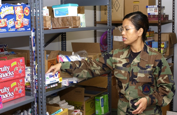 Tech. Sgt. Sheila White, 30th Mission Support Squadron, prepares care packages for deployed military members at the Airman Family Readiness Center on Feb. 21. Sergeant White, along with the Airman Family Readiness Center, takes care of troops that are deploying and family members of deployed troops.  (U.S. Air Force photo by Airman 1st Class Matthew Plew)