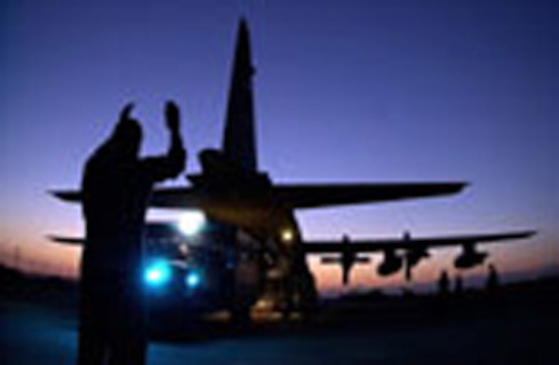 During Operation Northern Watch, Staff Sgt. Doug Perkins directs an ambulance into position to unload lifesaving equipment into the aircraft. The deployed medical team is from the 59th Medical Wing, Wilford Hall Medical Center at Lackland Air Force, Texas, and assigned to the 39th Medical Group at Incirlik Air Base Turkey. Sergeant  Perkins is assigned to Moody AFB, Ga. (U.S. Air Force photo by Master Sgt. Keith Reed)