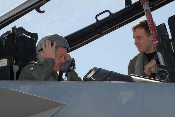 Glen McDonald, Bay County Chamber of Commerce Military Affairs Committee chairman, prepares for his first flight in an F-15 Eagle March 5 with the assistance of Capt. Chad James, 2nd Fighter Squadron pilot.  During his immersion here, Mr. McDonald visited the 325th Medical Group and 325th Maintenance Group to learn about our mission and relay it to the community.