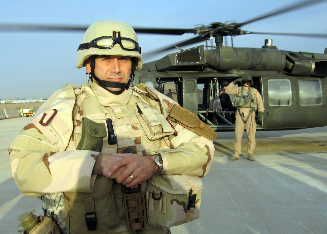 BALAD AIR BASE, Iraq -- Chaplain (Capt.) Dave DePinho prepares to board a UH-60 Blackhawk helicopter on his way to a forward operating location in Iraq. The wing's chaplains are responsible for offering spiritual care to Airmen assigned here 	and to forward locations wherever they may be. They are accompanied by chaplain assistants who provide protection and security, as well as ministry support for the chaplains who are considered non-combatants.