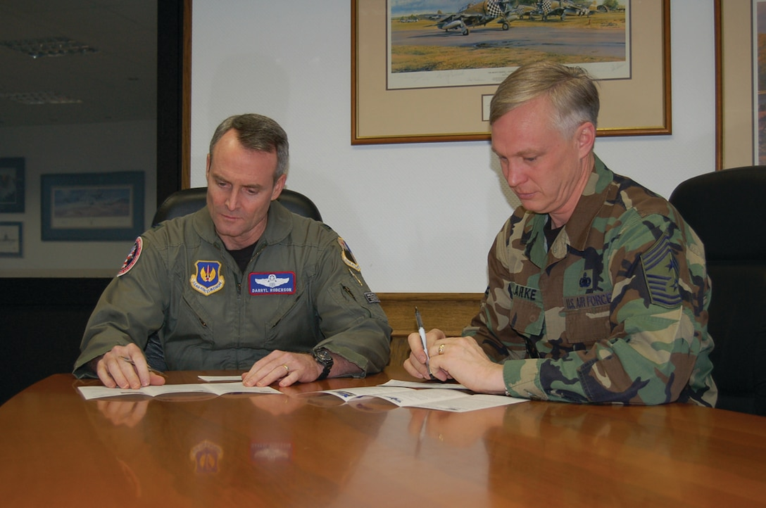 Col. Darryl Roberson, 52nd Fighter Wing commander, and Chief Master Sgt. Vance Clarke, 52nd FW command chief, complete their campaign forms for the AFAF Monday. Deductions for AFAF allotments begin June 1 and end May 31. For more information about the Air Force Assistance Fund, contact a unit representative. (US Air Force photo/Staff Sgt. Tammie Moore).