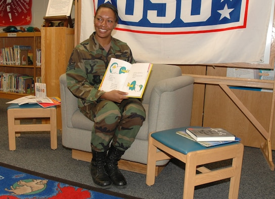 "OSAN AIR BASE, Republic of Korea --  Senior Airman Amayou Smith reads ""One Fish, Two Fish, Red Fish, Blue Fish"" into the camera as part of the ""United Through Reading"" program here. United Through Reading is a Family Literacy Foundation and United Services Organization program that allows servicmembers at remote locations to read to their children or young family members on video. Airman Smith is with the 51st Communications Squadron. (U.S. Air Force photo by Staff Sgt. Benjamin Rojek)"