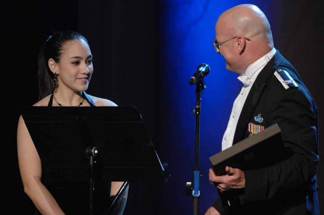 Betty Macias receives a plaque of appreciation from Col. Dennis Layendecker, U.S. Air Force Band commander and conductor, after her performance at the Guest Artist Series concert at the Daughters of the American Revolution Hall in Washington March 4. Ms. Macias was the 2007 winner of the Col George S. Howard Young Artist competition. (U.S. Air Force photo by Airman 1st Class Timothy Chacon)