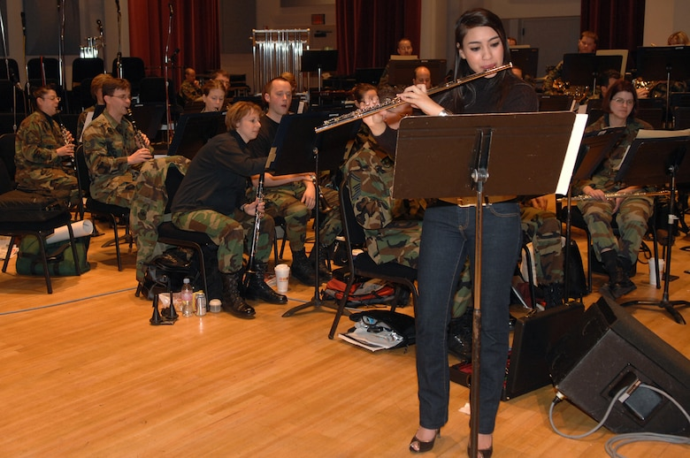 Betty Macias practices a flute solo with the U.S Air Force Band for her upcoming performances during the Guest Artist Series concert at the Daughters of the American Revolution Hall in Washington March 4. Ms. Macias was the 2007 winner of the Col. George S. Howard Young Artist competition. (U.S. Air Force photo by Airman 1st Class Timothy Chacon)