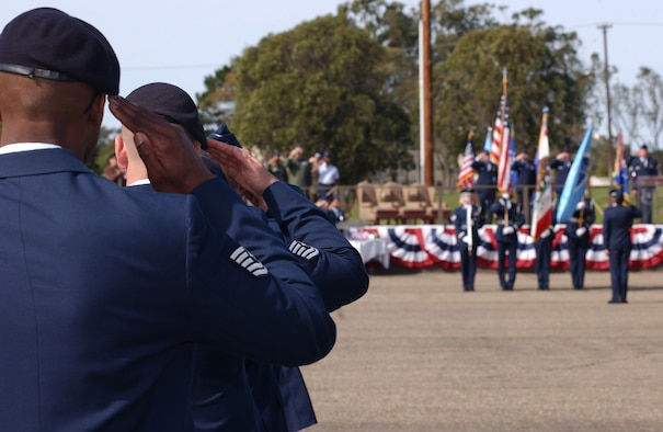 Members of the 30th Space Wing salute the colors during the 30th Space Wing change of command at Vandenberg on March 5.  The change of command signifies a change in base commander for the next two years. (U.S. Air Force photo by Airman Adam Guy)