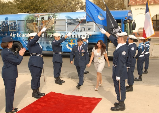 "Members of Headquarters Air Force Recruiting Service and the San Marcos High School Air Force Junior ROTC Color Guard give Operation Blue Suit XXVIII winners and their guests ""the red carpet treatment"" as they arrive at Randoloph Air Force Base, Texas, in March 2007. Each year Operation Blue Suit recognizes top Air Force recruiters worldwide. (U.S. Air Force photo)"