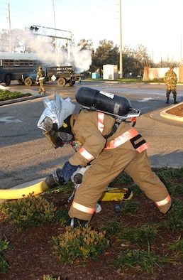 Airman 1st Class Shawn Edgecomb, 81 Civil Engineer Squadron, Keesler Air Force Base, attaches a hose to a fire hydrant in order to put out a simulated train derailment and building fire during a major accident response exercise today.  The exercise was designed to test Biloxi and Keesler Air Force Base first-responders' ability to work together.  (U.S Air Force photo by Kemberly Groue)
