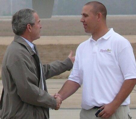 President Bush thanks Airman Petz for his volunteer service.
