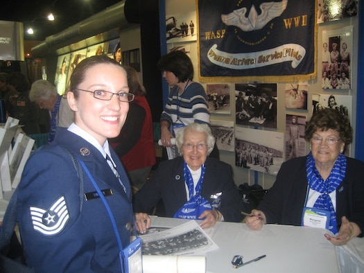 ORLANDO, Fla.--Tech. Sgt. Elizabeth Tinsley, 445th Aeromedical Evacuation Squadron, talks to members of the Women's Airforce Service Pilots (W.A.S.P.) of WWII at their exhibit during the 2007 Women in Aviation Conference.  This year the conference drew the largest crowd in their 18 year history.