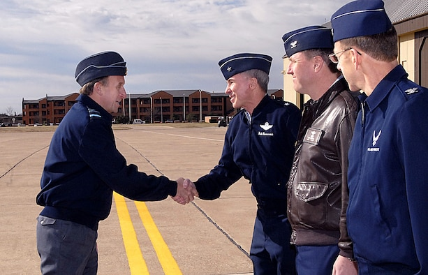 Brig. Gen. Richard Devereaux, 82nd Training Wing commander, greets British Royal Air Force Air Marshal Barry Thornton, Commander in Chief of Personnel and Training Command upon his arrival at Sheppard Air Force Base, Texas, March 6. The air marshal was also greeted by Col. Jeffery Kendall, 80th Flying Training Wing Commander, and Col. Lansen Conley, 82nd TRW vice commander. Air Marshal Thornton spent the day at Sheppard visiting training locations across base. (U.S. Air Force photo/Harry Tonemah)