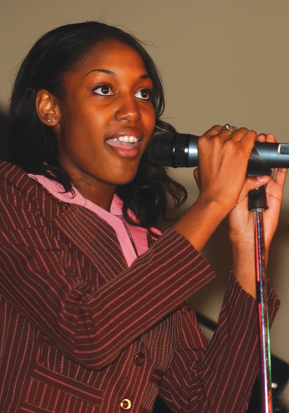SPANGDAHLEM AIR BASE, GERMANY -- Amber Williams, one of two dependent selected to compete in the USAFE idol competition, performs at the Brick House March 2. The contest winner was Capt. Stephanie Bankston, 52nd Medical Group, who moves on to the U.S. Air Forces in Europe level competition April 14. As part of the Extreme Summer program Anthony Fedorov, fourth place finisher in American Idol, visits the Brick House April 15 for photos and autographs.  (US Air Force photo by/Senior Airman Josie Kemp)