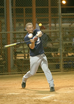 Lackland Warhawks third baseman Tony Formell swings hard against CFA Bomb Squad during the first game of the San Antonio Parks and Recreation Spring Softball League March 6 at the Alva Jo Fischer Memorial Softball Complex. Formell went 2-for-3, doubled and scored. (USAF photo by Robbin Cresswell)