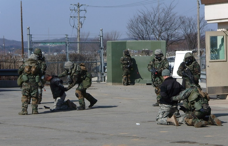 """OSAN AIR BASE, Republic of Korea --  Air Defenders of Charlie Battery1-43 Air & Missile Defense Battalion, 35th Air Defense Artillery Brigade apprehend opposing forces """"bad guys"""" during a recent Mission Rehearsal Exercise at Osan Air Base. (U.S. Army photo)"""