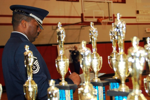 "WRIGHT-PATTERSON AFB, Ohio – Air Force reservist Master Sgt. Mark Lyle,Superintendent of the 445th Airlift Wing Honor Guard, is surrounded by trophies.  Sergeant Lyle was a judge at the Junior Reserve Officers' Training Corps (JrROTC) ""All Air Force Regional Drill Meet"" that was held at Tecumseh High School, New Carlisle, Ohio. (U.S. Air Force photo/Tech. Sgt. Charlie Miller)"