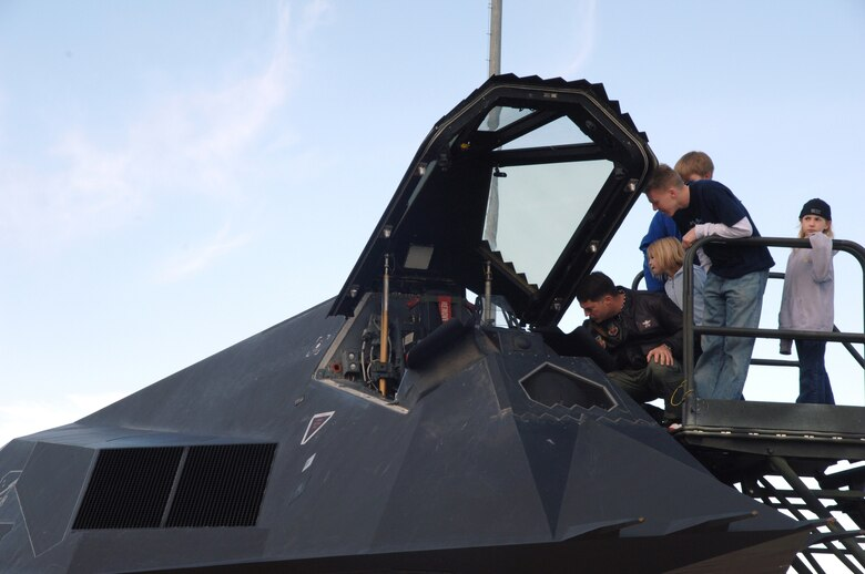 Families were able to look in the cockpit of the F-117A Nighthawk before six were retired to Tonopah Test Range, Nev., March 12 (U.S. Air Force photo by Airman !st Class Tiffany Mayo)