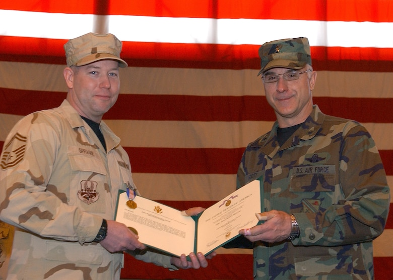 Senior Master Sgt. Dean Sprague, 354th Logistics Readiness Squadron, poses with 354th Fighter Wing Commander Brig. Gen. Dave Scott during a Welcome Home Ceremony for returning deployed airmen at Eielson Air Force Base, Alaska March 9.  Sergeant Sprague recieved the Soldier's Medal for his heroic efforts, which saved the lives of five Afghan civilians during his deployment.  (U.S. Air Force Photo/Staff Sgt. Tia Schroeder).