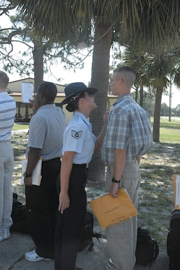 Staff Sgt. Natasha Hebert, 320th Training Squadron military training instructor, welcomes an ROTC cadet to Tyndall AFB in 2006.