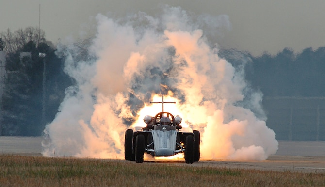 "The Air Force Reserve Jet Car, driven by retired Master Sgt. Bill Braack, prepares to thunder down the flightline at Dobbins Air Reserve Base, Ga., in a display for Junior Reserve Officer Training Corps. The performance is part of a week-long program to introduce cadets to the world of the military, including career displays, a C-130 orientation flight, and visits by senior leaders, as part of ""Heritage to Horizons,"" the Air Force's 60th anniversary celebration, culminating with Air Force Week Atlanta, Oct. 8-14."