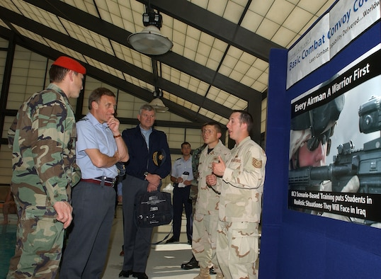 Tech. Sgt. Robert Miller, 342nd Training Squadron, explains the concept of the Basic Combat Convoy Course to British Air Marshal Barry Thorton (center left), Personnel and Education commander of the Royal Air Force, during a visit to Lackland Air Force Base, Texas, March 5. Air Marshal Thornton, the U.K. Royal Air Force's counterpart to Air Education and Training Command Commander Gen. William Looney III, visited four AETC bases - Lackland, Randolph, Sheppard and Maxwell - to get fresh ideas for improving education and training for Royal Air Force airmen. (USAF photo by Harry Tonemah)