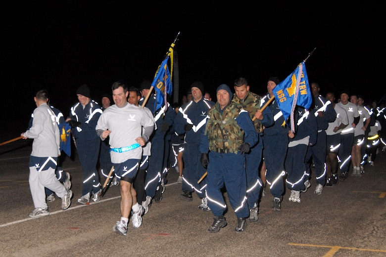 Col. Scott Bethel leads the 17th Training Wing in the Warrior Run March 2. The event was Col. Bethel's last warrior run as 17 TRW commander. Also leading the charge were Col. Stephen Czerwinski, 17th Mission Support Group commander (right, in flak vest) and 1st Lt. Dean Smith (carrying guidon behind Col. Czerwinski, also in flak vest). Airmen from the 17 MSG, 17th Medical Group, 17th Training Group and the Goodfellow NCO Academy, as well as Soldiers from the 344th Military Intelligence Battallion, Sailors from the Center for Information Dominance and Marines from the Marine Corps Detachment, all took part in the 2.2 mile run.